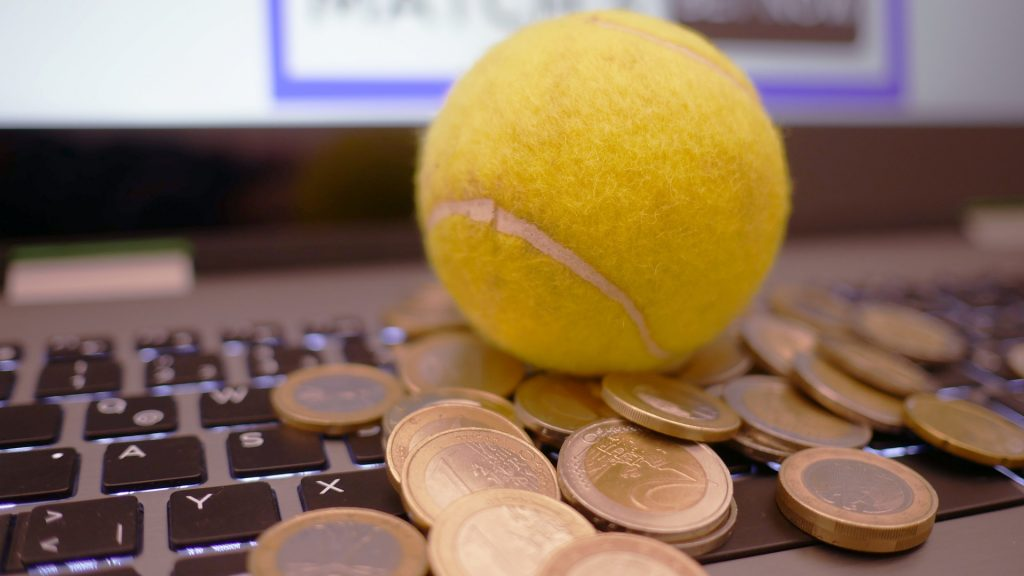 A close up of a keyboard with coins and ball